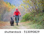 man on a bicycle with her dog...   Shutterstock . vector #513090829