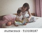 young dark haired mother and... | Shutterstock . vector #513108187