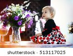 the little girl sits with a... | Shutterstock . vector #513117025