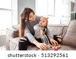 mother and baby on bed. so cute ... | Shutterstock . vector #513292561