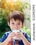 asian little boy drinking milk... | Shutterstock . vector #513392995