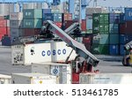 Small photo of GENOA, ITALY - JULY 7, 2011: Forklifts at work in the port container terminal. In the picture, containers hanjin, Cosco, Kline, Yang Ming and Uasc.