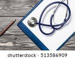 doctors wooden table with... | Shutterstock . vector #513586909