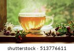 Stock photo a cup of tea with tea leaves on the windowsill tea on the background of nature among the herbs 513776611