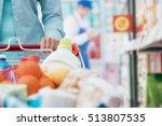 woman pushing a shopping cart... | Shutterstock . vector #513807535