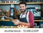 portrait of smiling waiter... | Shutterstock . vector #513812209