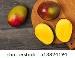 mangoes on wooden chopping... | Shutterstock . vector #513824194