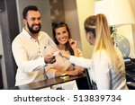 Stock photo picture of couple and receptionist at counter in hotel 513839734