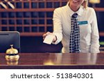 Stock photo picture of receptionist giving key card 513840301