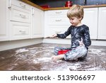 a boy sitting on the kitchen... | Shutterstock . vector #513906697