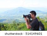 man of photographers holding...   Shutterstock . vector #514149601
