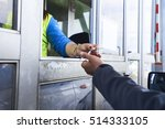 People  Hand Paying Toll Way O...