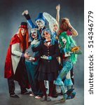 Small photo of The troupe of mad circus actors on the grey background.