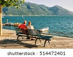 Couple Sitting On The Bench At...