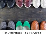 shoes on a wooden background   Shutterstock . vector #514472965