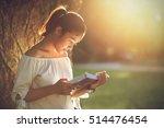 asian girl reading book at park ... | Shutterstock . vector #514476454