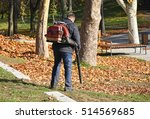 man is cleaning leaves in the... | Shutterstock . vector #514569685