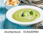 broccoli cream soup on blue... | Shutterstock . vector #514630984