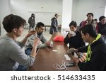 Small photo of Thessaloniki, Greece - March 10, 2016. Afghan refugees play cards, inside the refugee camp of Diavata village, near the northern Greek city of Thessaloniki.
