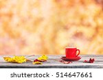 red cup and autumn leaves on... | Shutterstock . vector #514647661