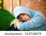 sad teenager sit by the brick...   Shutterstock . vector #514718479