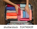 Woman Packing A Luggage For A...