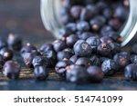 juniper berries spilled from a... | Shutterstock . vector #514741099