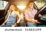 couple driving in a sport car | Shutterstock . vector #514831399
