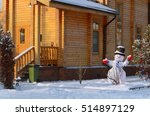 Snowman On The Background Of A...