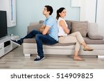 sad young couple sitting back...   Shutterstock . vector #514909825