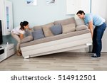 young happy couple placing sofa ... | Shutterstock . vector #514912501