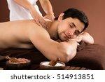 young man receiving shoulder... | Shutterstock . vector #514913851