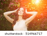 young woman and flowers  | Shutterstock . vector #514966717