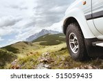 jeep car wheel on hill top on... | Shutterstock . vector #515059435