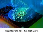 Computer hard drives with technology fiber optics background - stock photo