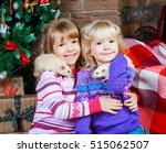 two sisters at home with pet... | Shutterstock . vector #515062507