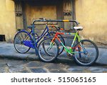 Colorful Bikes Parked By The...