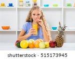 beautiful girl enjoys drinking... | Shutterstock . vector #515173945