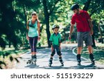 Cheerful Family Roller Skating...