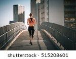 female running on a city bridge.... | Shutterstock . vector #515208601
