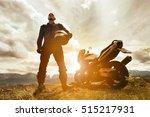 biker stands with motorcycle... | Shutterstock . vector #515217931