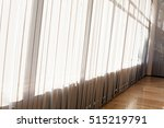 White Striped Curtains In The...