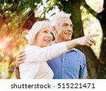senior couple relaxing in park | Shutterstock . vector #515221471