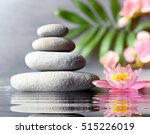 spa stones with flower lily on... | Shutterstock . vector #515226019