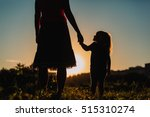 Silhouette Of Mother And...