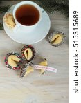 Small photo of Fortune cookies and a cup of tea on the table it will turn out all right at the end