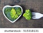 fresh raw broccoli in a white... | Shutterstock . vector #515318131