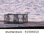 A Crab Pot Sits On A Pier In...
