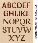Small photo of Latin alphabet. Coffee and tea on the texture background. The photo.
