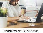 female coworker using laptop... | Shutterstock . vector #515370784